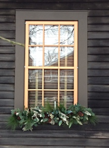 Christmas greenery in the window